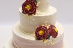 Kāzu torte ar sviesta rozēm