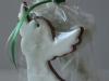 Egles rotājumi - piparkūku un dekoratīvs eņģelis dāvanu maisiņā.