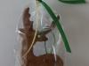 Piparkūku briedis - egles rotājums dāvanu maisiņā.