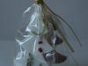 Egles rotājumi - dekoratīvā un piparkūku Ziemassvētku egle dāvanu maisiņā.