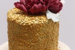 Zelta un marsala krāsas kazu tortei