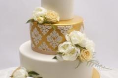 Šokolādes kāzu torte ar reljefa rakstiem un zeltu